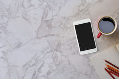 Marble desk table with a red mug and color pencil. Top view with copy space, flat lay or hero header concept Royalty Free Stock Images