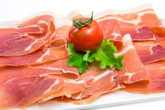 Marble dish with raw ham Royalty Free Stock Photography