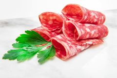 Marble dish with salami slices Royalty Free Stock Images