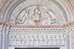 Marble doorway. God carried by two angels Royalty Free Stock Image