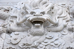 The marble dragon head. The Chinese marble sculpture of dragon head with cloud pattern Royalty Free Stock Image
