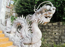Marble dragon sculpture. Asian dragon Marble statue, sculpture in buddhist pagoda. Ornaments, multicolored tiles decorated with beautiful fantastic dragon in the Royalty Free Stock Images