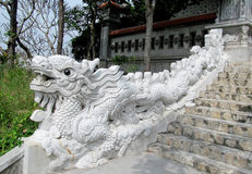 Marble dragon on stairs Royalty Free Stock Image