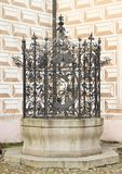 Dwell palace Breznice. Marble dwell with iron fittings on courtyard of renaissance palace Breznice with renaissance envelopes on plaster in Czech Republic Stock Photo