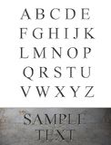 Marble Engraved Alphabet. He letters of the alphabet engraved in marble or stone Royalty Free Stock Image