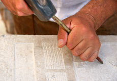 A marble engraver at work Stock Photo