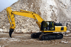 Marble Excavator Ripper. Yellow excavator in quarry with ripper material Royalty Free Stock Photo