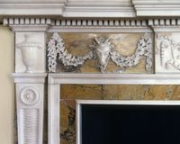 Marble fireplace detail. Section of an old carved marble fireplace royalty free stock image