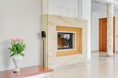Marble fireplace in lounge Stock Photography