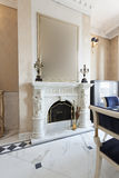Marble fireplace in luxury villa.  royalty free stock photography