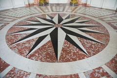 Marble floor with star form Royalty Free Stock Photo