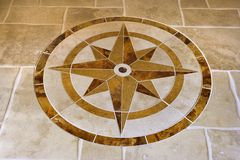 Marble floor with star shape. Stock Photos
