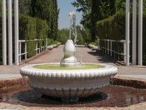 Marble fountain into a garden Stock Photography