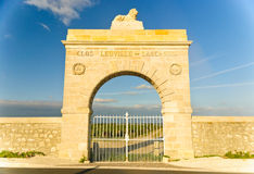 Marble gate - arc to vineyard, Medoc, France. Marble gate in the shape of arc to Chateau Leoville-Lascases vineyard in region Medoc, Bordeaux, Franc Royalty Free Stock Image