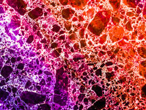 Marble granite red purple colorful explosion of dimension inside. Texture stone Royalty Free Stock Photo