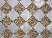 Marble and gravel checker board pattern floor Stock Photo