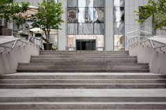 Marble grey stairs to the entrance of modern building Royalty Free Stock Images