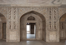 Marble hall of the palace, decorated with richly carved and inlaid. Agra, India. Beautiful carved and incrusted room inside the palace at Red Fort Stock Photography