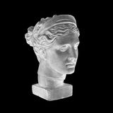 Marble head of young woman, ancient Greek goddess bust isolated on black background. Marble head of young woman, ancient Greek goddess bust isolated on black Stock Photo