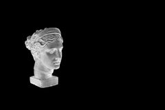 Marble head of young woman, ancient Greek goddess bust isolated on black background with copy space for text. Stock Photos