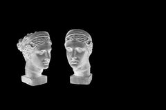 Marble head of young woman, ancient Greek goddess bust isolated on black background. Royalty Free Stock Photography