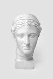 Marble head of young woman, ancient Greek goddess bust isolated on white background.  Royalty Free Stock Photography