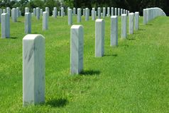 Marble Headstones in a Graveyard. Rows of white marble headstones at the Florida National Cemetery in Bushnell, Florida royalty free stock photo