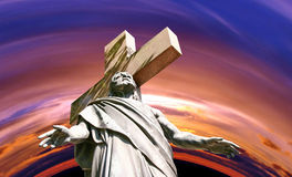 Marble Holy cross with crucified Jesus Christ. Against dramatic sunset Stock Photography