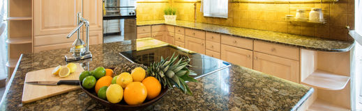 Marble island inside expensive kitchen Stock Photos