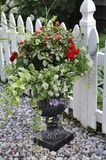 Marble Jardiniere with Beautiful Flowers Arrangement from Downtown of Niagara-on-the-Lake in Ontario province. Of Canada on 25th June 2017 Royalty Free Stock Photo