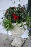 Marble Jardiniere with Beautiful Flowers Arrangement from Downtown of Niagara-on-the-Lake in Ontario province. Of Canada on 25th June 2017 Stock Image