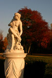 Marble lady. Marble baroque sculpture in autumn landscape Royalty Free Stock Photos