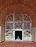 Marble Latice and Arch at Emperor Akbar's Tomb. The tomb of Mughal Emperor Akbar is one of the many Mughal Architectural highlights to be seen in Agra. The Stock Photos