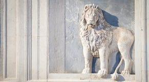Marble lion on church facade Stock Image