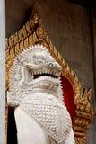 Marble lion guarding entrance (Wat Benchamabophit Dusitvanaram) Stock Photography