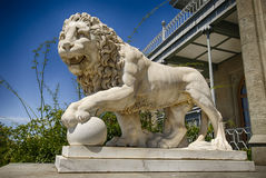 Marble lion statue of Vorontsov palace in Crimea Russian Federation. Marble lion statue in front of facade of Vorontsov palace in Crimea Russian Federation stock photo
