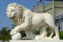 Marble lion - Vorontsov Palace, Crimea. This marble lion sculpture is situated in Vorontsov Palace - Alupka, Crimea. The lion and palace are situated against the royalty free stock image