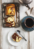 Marble loaf cake. And cup of tea on wooden table. Top view Stock Photos