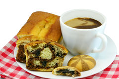 Marble loaf, cookies and milk coffeee. Marble loaf cake, cookies and milk coffee on a tissue, isolated on white royalty free stock photos