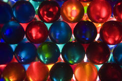 Marble Macro Team Abstract. A column of marbles makes a light abstract to show how items work together to form one unit stock image