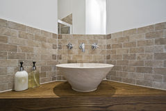 Marble made hand wash basin. On a wooden corner table Stock Photography