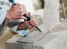Marble. Man who carves the marble with the chisel royalty free stock photos