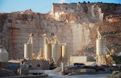 Marble mine. Marble open cast mining with silos Stock Image
