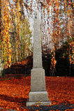 Marble monument in autumn Royalty Free Stock Photos