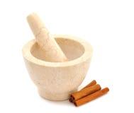 Marble mortar and cinnamon Royalty Free Stock Photos