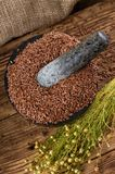 Marble mortar full of flax seeds and stone thumper Stock Images