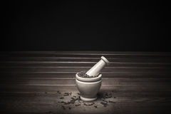 Marble mortar with spices black pepper and carnation Royalty Free Stock Photos
