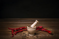 Marble mortar with spices black pepper, carnation and red hot pepper Royalty Free Stock Photography