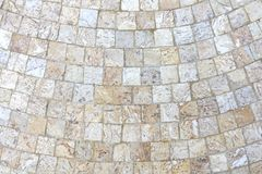 Marble mosaic background 2. Natural marble cubes in light shades arranged in bent lines Stock Photo