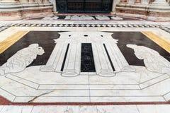 Marble mosaic floor near door of Siena Cathedral Santa Maria Assunta, Duomo di Siena, Italy. Marble mosaic floor near door of Siena Cathedral Santa Maria Assunta royalty free stock photos